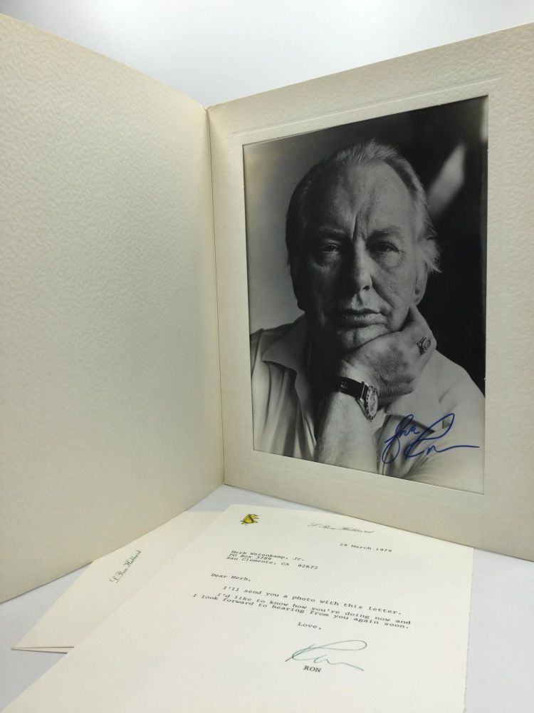 AUTOGRAPH PHOTO AND TYPED LETTER SIGNED. L. Ron Hubbard.