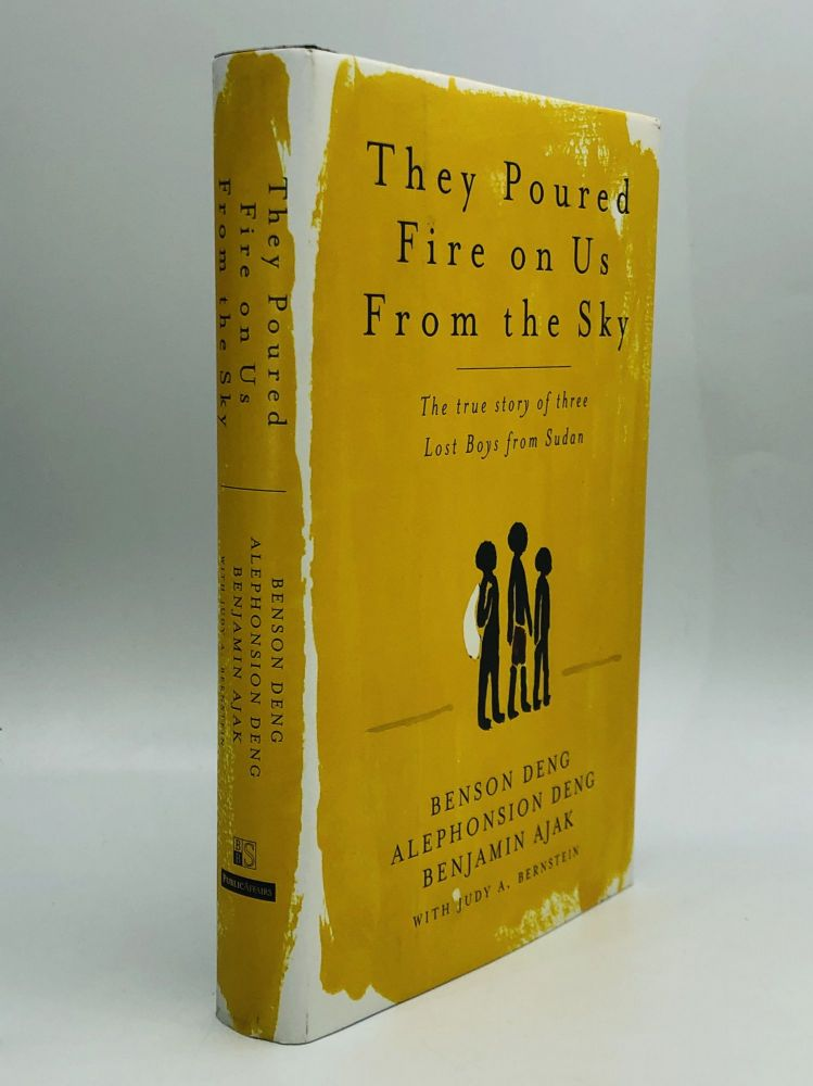 THEY POURED FIRE ON US FROM THE SKY: The True Story of Three Lost Boys from Sudan. Benson Deng, Alephonsion Deng, Benjamin Ajak, Judy A. Bernstein.
