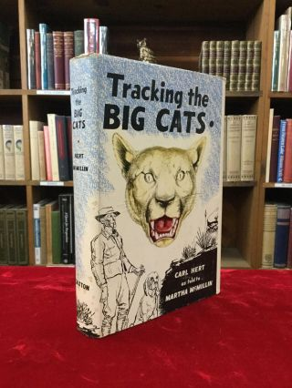 TRACKING THE BIG CATS. Carl as told to Martha McMillin Hert